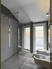 glass shower cubicle in a modern bahtroom and sanitary ware