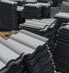 load of roofing tiles at a residential home construction site.