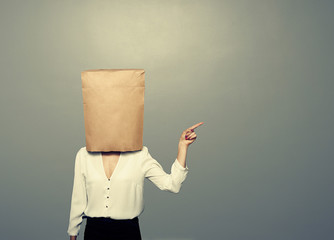 woman with paper bag on the head
