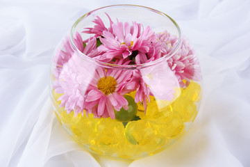 Beautiful flower in vase with hydrogel on fabric background
