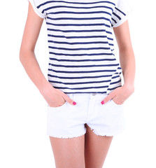 Beautiful young girl in shorts and t-shirt, close-up, isolated