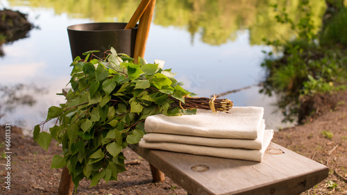 Finnish summer landscape and sauna objects on bench by lake. - 66011331
