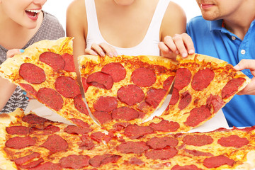 Group of friends with pizza