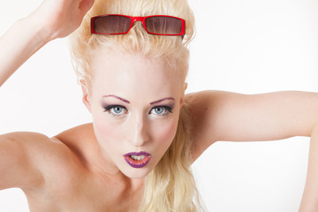 Young blond woman aggressive look