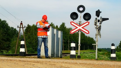 Railroad workers with folders near signal beacons episode 4