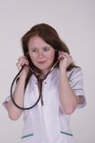 Female medical practitioner holding stethoscope