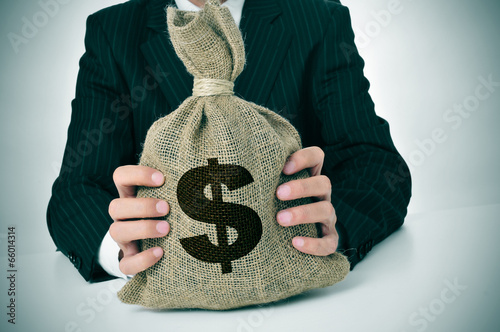 man in suit with a burlap money bag