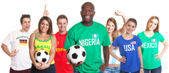Laughing soccer fan from Nigeria with ball and other fans