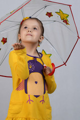 The little girl with an umbrella