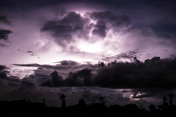Thundercloud illuminated by lightning