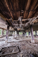 Abandoned factory hall and burnt ceiling