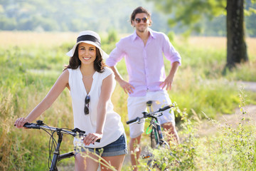 Smiling young couple with bicycles