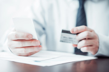 Smartphone and Credit Card in Hands