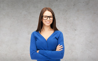 smiling businesswoman or student in glasses
