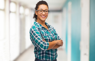 smiling young woman in eyeglasses at school