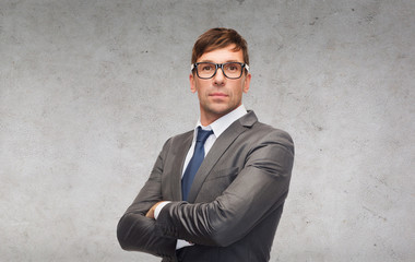 attractive businessman or teacher in glasses