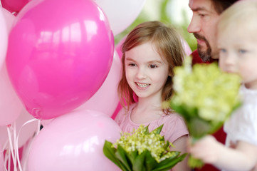 Little birthday girl with pink balloons