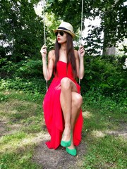 Dressed up woman on a swing, outdoors