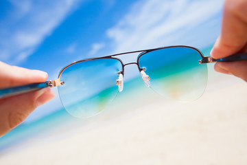 close up of sunglasses. sunny beach in thailand