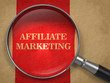 Affiliate Marketing Concept Through Magnifying Glass.