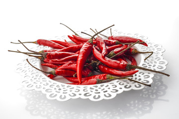 red peppers on decorated white tray