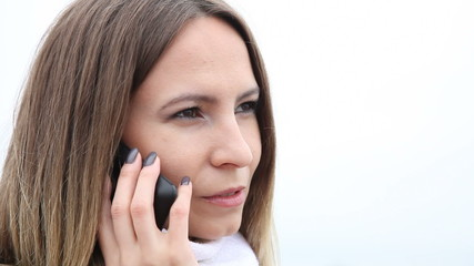 Young woman talking on cell phone outdoor