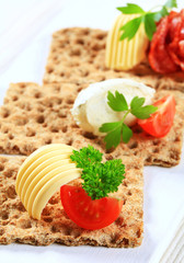Whole grain crispbread with various toppings
