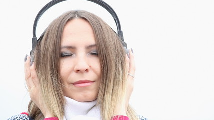 Young woman with headphones listening to chillout music