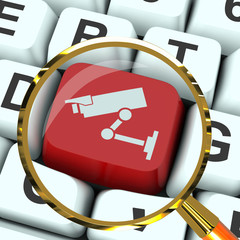 Camera Key Magnified Shows CCTV and Web Security