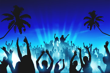 Silhouettes of People in an Outdoor Concert