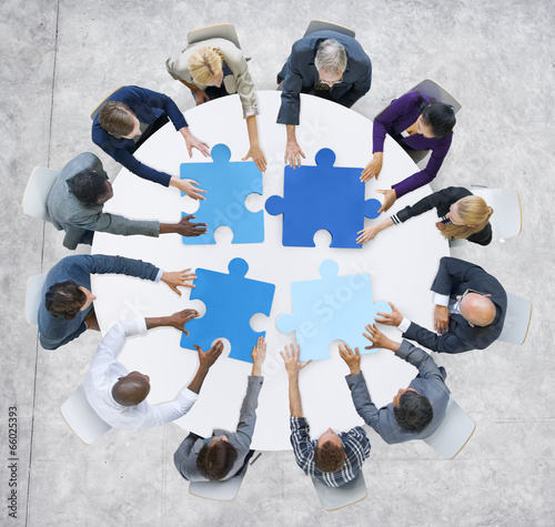 Business People and Jigsaw Puzzle Pieces - 66025393