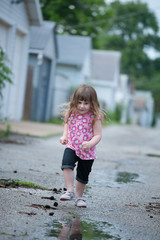 girl and a puddle