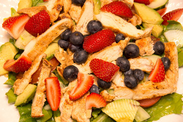 Strawberry, blueberry, lettuce salad with roasted chicken