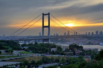 Bosphorus Bridge sunset behind the trees