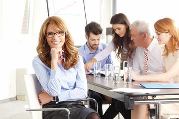 Beautiful executive businesswoman at meeting.
