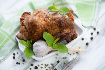 Smoked spicy chicken with mint, garlic and pepper, studio shot