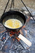 making food on camp fire