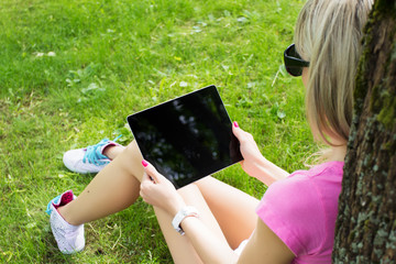 Girl with tablet computer outdoors