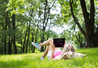 Girl using tablet computer outdoors
