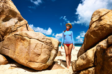 Woman at beautiful beach wearing rash guard