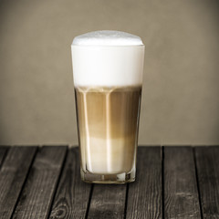 Glass of rich foamy Italian Macchiato coffee