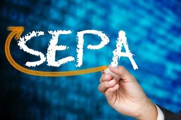 Businessman writing the word sepa
