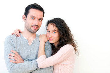 Portrait of a young happy couple on a white background