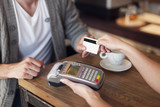 Close up of customer paying by credit card