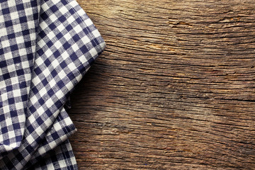 checkered napkin on old wooden table