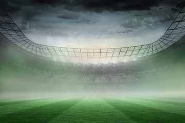 Misty football stadium under spotlights