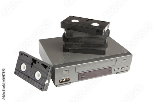 stack of videotapes on videorecorder isolated on white