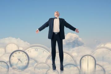 Asian businessman fly over clocks