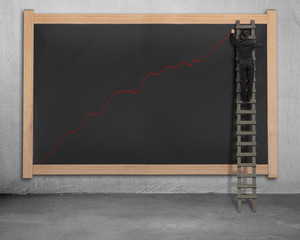 Drawing growing red trend on black board