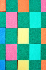 Background made of colorful scouring sponges